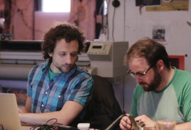 Picture of two guys making things.