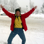 Patricia with arms raised celebrating a snowfall!