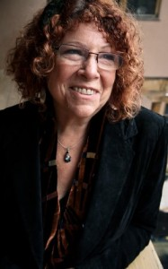 Headshot photo of Margaret Wheatley, curly hair, smiling and wearing glasses.