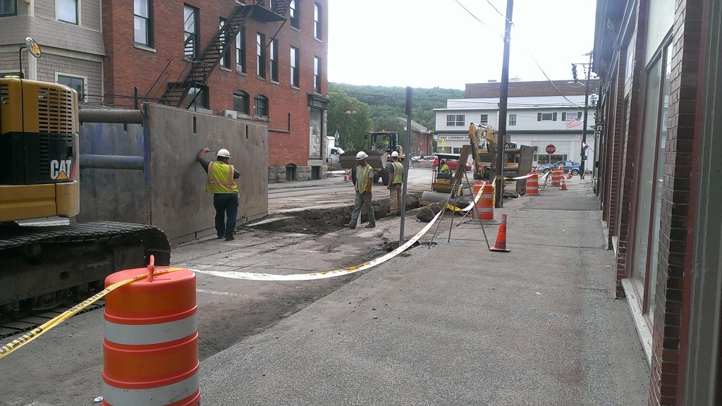 Picture of workers carving out a dig in the street.